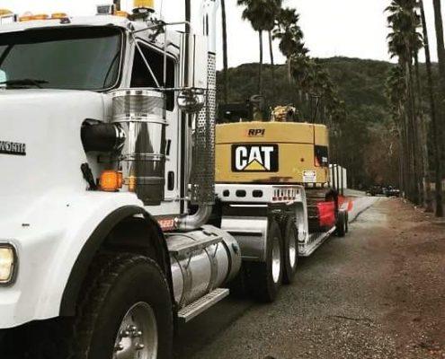 CAT hauling lowbed